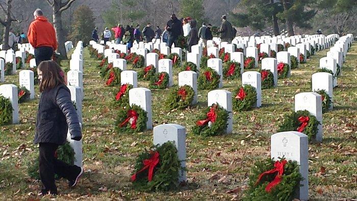 Wreaths Across America volunteers place wreaths at Arlington National Cemetery