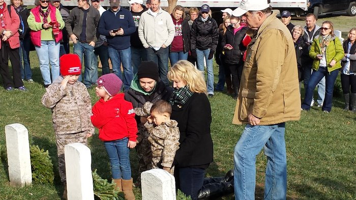 Worcester grandchildren salute the grave of William Christman at Arlington after laying the last wreath.