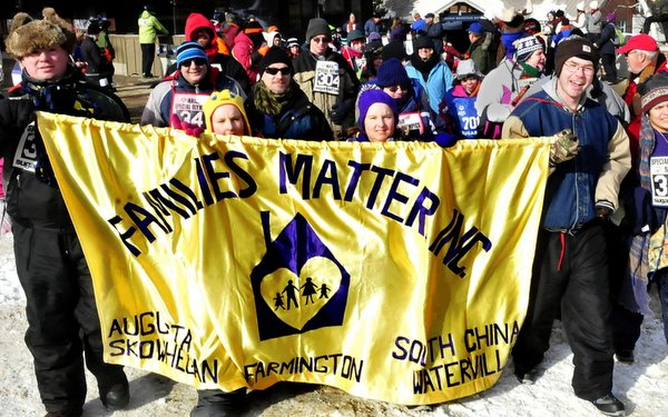 """Members of """"Families Matter"""" march in the Opening Ceremony of the 2015 Maine Special Olympics Winter Games at Sugarloaf USA."""