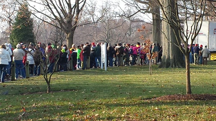Volunteers in line to receive wreaths to place on headstones at Arlington National Cemetery.