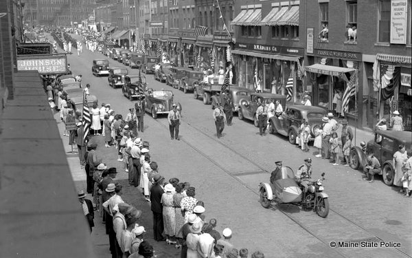 Parade in Maine circa 1940s with Maine State Police motorcycle with sidecar