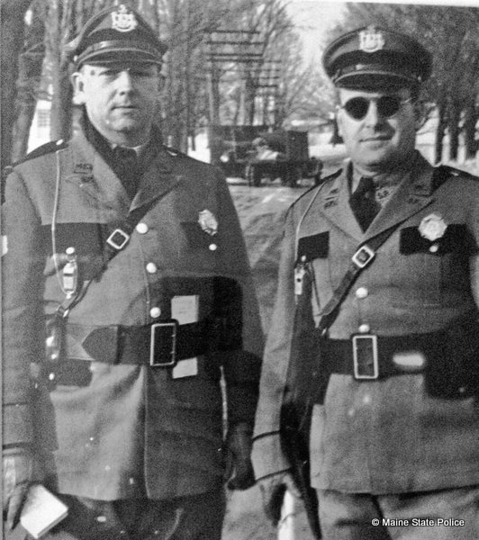Jan. 1945-Troopers Forrest McIver and Ken Twitchell man a checkpoint in Farmington, ME.