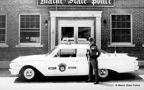 1960-Trooper Herman Boudreau at Maine State Police HQ Augusta with Special Edition Highway Safety Ford