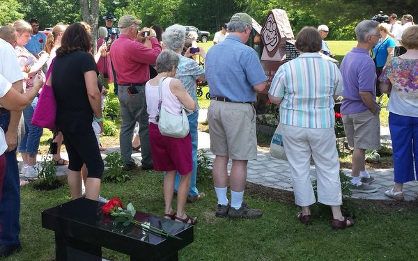 Families, friends and supporters of Parents of Murdered Children attend the dedication of the Memorial to Murdered Children in Augusta, ME.