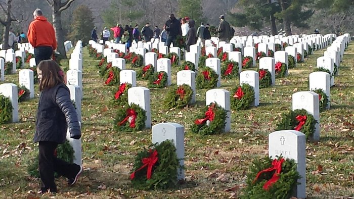 Wreaths Across America volunteers place wreaths at Arlington National Cemetery
