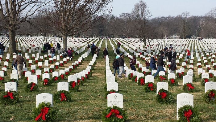 Wreaths Across America volunteers continue laying wreaths at Arlington National Cemetery