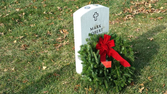 Headstone of Mark Robert Coleman, former Maine State Trooper, decorated with wreath provided by Wreaths Across America