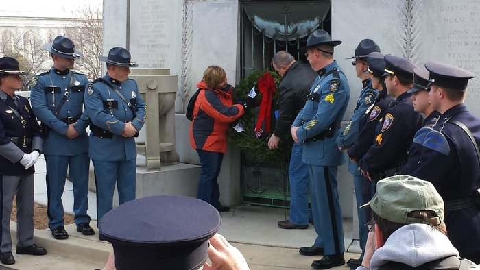 Maine Governor Paul LePage and wife Ann lay a wreath at the USS Maine Mast Memorial, honoring those who died on the USS Maine on February 15, 1898 in Havana Harbor in Cuba. Maine State Police Troopers, Portland ME and Westbrook ME police in attendance.