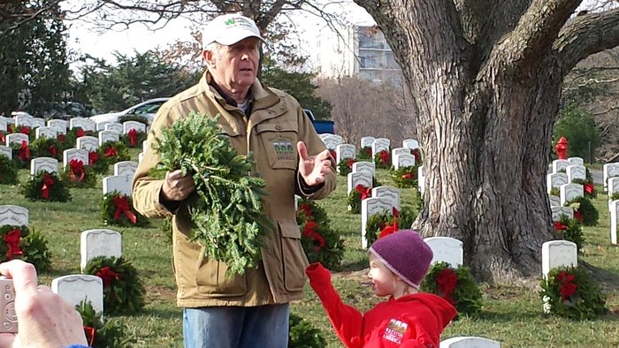 Morrill Worcester, owner of Worcester Wreaths of Harrington, ME, founder of Wreaths Across America, prepares to lay the last wreath of the ceremony.