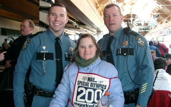 Trooper Aaron Turcotte and Sgt. Matt Casavant with contestant at 2010 Maine Special Olympics Winter Games at Sugarloaf USA.