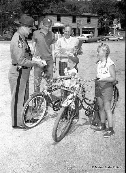 1959- Maine rooper Herman Boudreau performs bicycle inspections, Harrison, ME.
