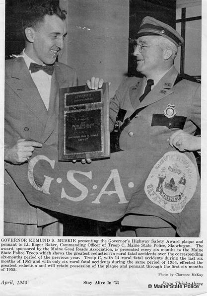 April 1955- Gov. Edmund Muskie presents Troop C Commander Lt. Roger Baker with Governors Safety Award