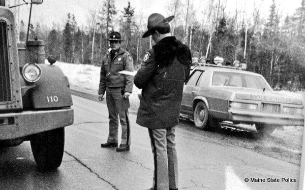 Dec. 1982-Maine Troopers Brian Theriault and Joe Doucette at safety checkpoint, US Rt. 1 Baring Township
