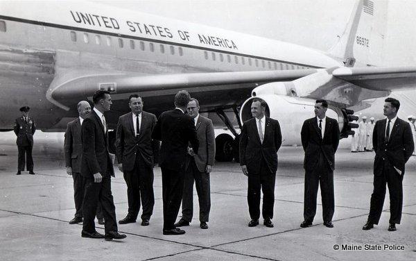 1963-President John F. Kennedy visits Maine. TRS. Edward Marks, Det. Millard Nickerson, Russ Bruton, Camille Carrier, Ken Higgins, Blaine Umbler